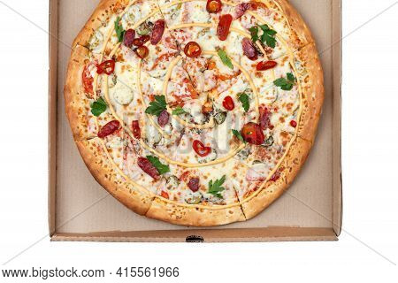Hot Pizza In A Cardboard Box. Tasty Pizza With Cheese, Sausage, Jalapenos And Tomatoes On A White Ba