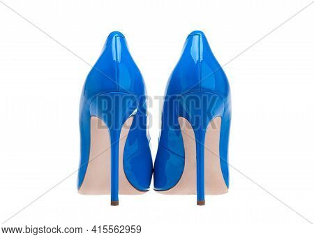 Women High-heeled Shoes. A Pair Of Beautiful Blue Shoes, Back View. Blue Patent High-heeled Shoes.