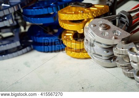 Climbing cams used in climbing on a table.