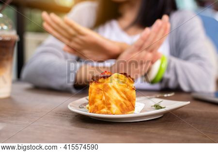 Blur Of Hands Woman Refusing Cake Or Junk Food In Restaurant,no Meal,diet Food Concept
