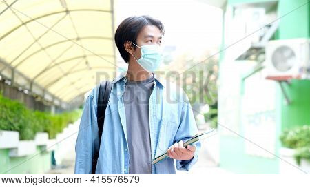 Young Asian Campus Student Man Wearing Protection Mask While Walking In Campus, Coronavirus Preventi