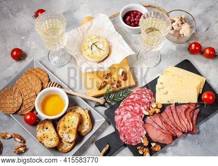 Antipasto Platter Cold Meat With Bread, Salami, Slices Ham And Cheese On A Concrete Background