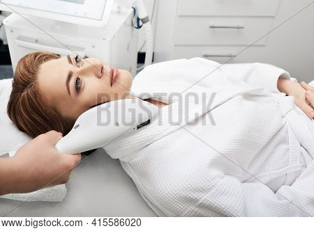 Beautician Removes Brown Spots On A Womans Skin In The Beauty Salon. Skin Rejuvenation Of A Beautifu