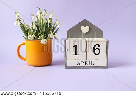 Calendar For April 16: Cubes With The Number 16, The Name Of The Month Of April In English, A Bouque