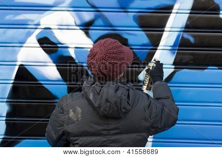 Artists Painting A Graffito