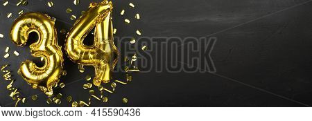 Golden Foil Balloon Number Thirty Four. Birthday Or Anniversary Card With The Inscription 34. Black