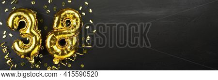 Golden Foil Balloon Number Thirty Eight. Birthday Or Anniversary Card With The Inscription 38. Black