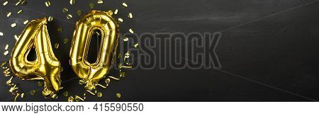 Golden Foil Balloon Number Forty. Birthday Or Anniversary Card With The Inscription 40. Black Concre