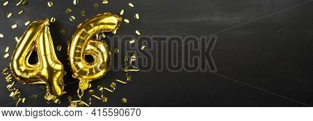 Golden Foil Balloon Number Forty Six. Birthday Or Anniversary Card With The Inscription 46. Black Co