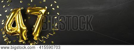 Golden Foil Balloon Number Forty Seven. Birthday Or Anniversary Card With The Inscription 47. Black