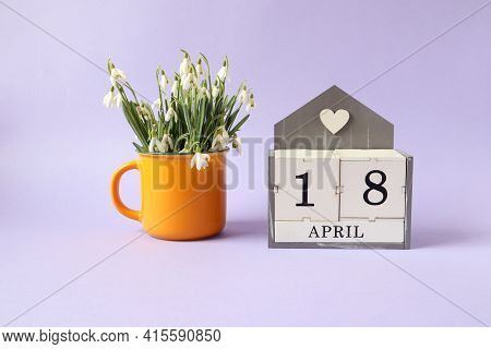 Calendar For April 18: Cubes With The Number 18, The Name Of The Month Of April In English, A Bouque