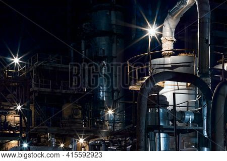 Night Industrial Petrochemical Landscape. Reactors Pipes And Columns. Large-capacity Production Ente