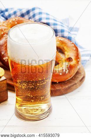 Lager beer mug and fresh baked homemade pretzel with sea salt. Classic beer snack