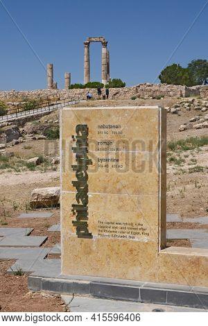 AMMAN, JORDAN - JULY 21, 2015: Sign at The Temple of Hercules at the Citadel of Amman, Jordan. Philadelphia is the former name of Amman.