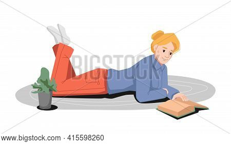 Blonde Reads Book Lying On Carpet At Floor, Flower Pot Nearby. Young Girl In Casual Cloth Studying A