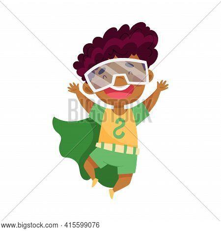 Cute African American Boy Wearing Cape As Superhero Jumping Pretending Having Power For Fighting Cri