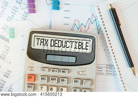 Tax Deductible Word On Calculator. Business And Tax Concept.