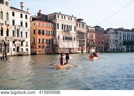 Venice, Italy - January 6 2014: Witches Rowing At Regatta Of Befana In Venice, Called Regata Delle B