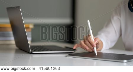 Close Up Hand Of Woman With Stylus Pen Writing On Digital Notepad, Touching On Digital Tablet Screen
