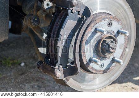 Pruszcz Gdanski, Poland - April 2, 2021: New Bosch Brake Pads On Disc Brake. Car Brake Repairing.