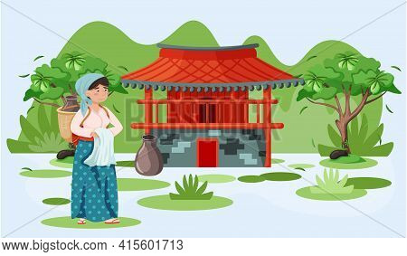 Woman In National Costume On Background Of Local Village. Red Building In Oriental Style In Jeju