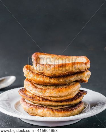 Stack Of Small Pancakes With Banana And Chia Seeds On Black Background. Pancake With Chia Or Poppy S