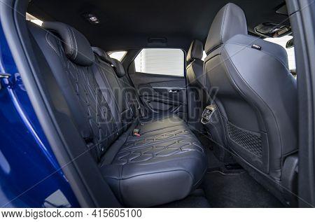 Row Of Passenger Rear Seats Upholstered In Black Interior Of Modern Passenger Car