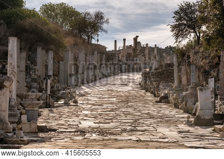 Historic marble slabs of the Curetes street in Ephesus Ancient City at sunny day in Selcuk, Turkey. Ancient and historical road from the roman period.