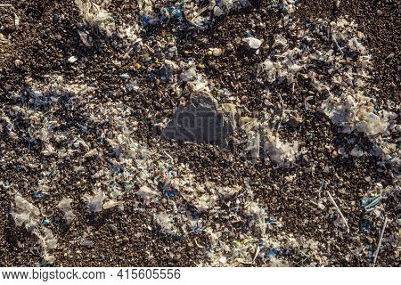 Small plastic parts and microplastics on the sand beach. Global ocean pollution. Microplastic in water and food. Global ocean pollution. Microplastic environment problem.