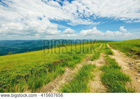 Country Road Through Alpine Meadow Of Carpathian Mountain. Beautiful Nature Landscape In Summer. Sce
