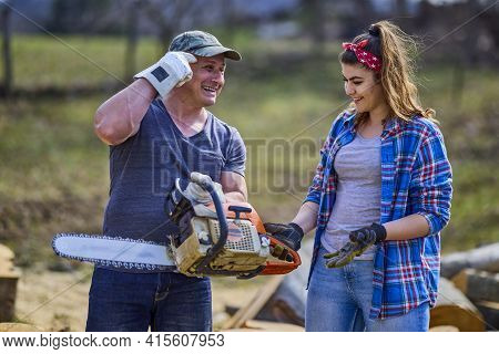Lumberjack Teaches His Apprentice How To Use The Chainsaw