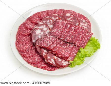 Sliced Dry-cured And Smoked Sausages Of  Different Types On White Dish On A White Background