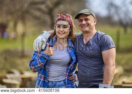 A Couple Of Woodcutters Show The Ok Sign