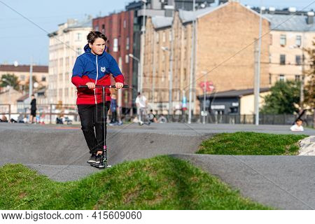 Riga, Latvia - September 30, 2020: The Teenage In The Skatepark Carries Out Various Tricks With Bicy