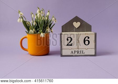 Calendar For April 26: Cubes With The Number 26, The Name Of The Month Of April In English, A Bouque