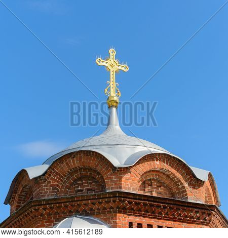 Gilded Pro-orthodox Christian Cross On The Dome Of The Church Against The Blue Sky