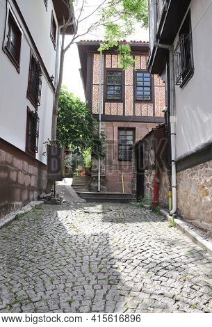 Cobblestone pavement and medieval houses in old town Kaleici in Ankara, Turkey