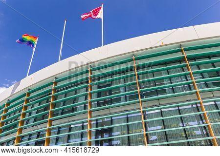 Assen, Netherlands - May 30, 2020: Flags On Top Of The Modern Town Hall Of Assen, Netherlands