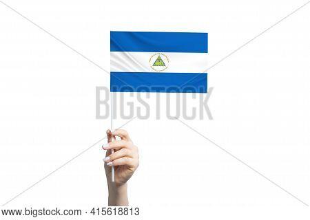 Beautiful Female Hand Holding Nicaragua Flag, Isolated On White Background.