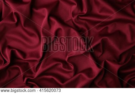 Smooth Elegant Burgundy Silk Or Satin Luxury Cloth Texture Can Use As Abstract Background. Luxurious