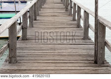 The Background Is A Beautiful Long Wooden Pier. Close-up