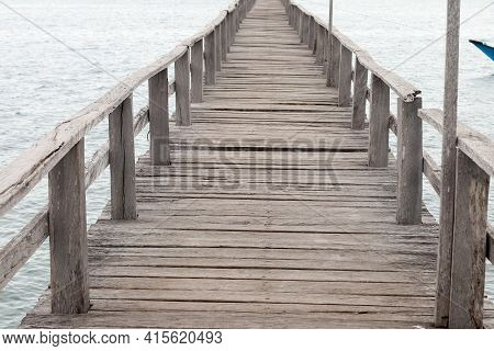 Old Wooden Pier On The Sea. Old Wooden Jetty Over The Sea Shore With Copy Space