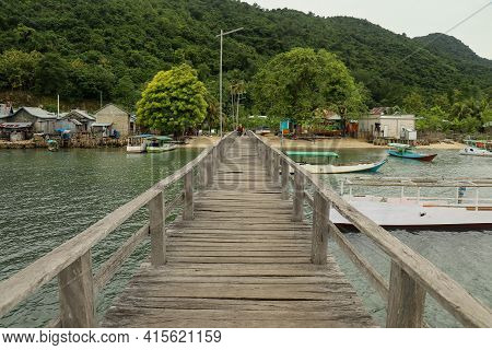 View From The Wooden Sea Pier On The Sea To. Shore And Village In Background