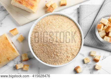Fresh Breadcrumbs On White Marble Table, Flat Lay