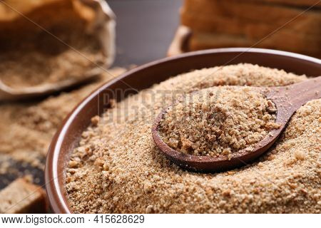 Fresh Breadcrumbs In Bowl And Spoon On Table, Closeup