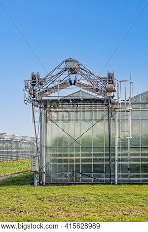 Greenhouse Deck Cleaner On The Roof Of A Dutch Greenhouse. A Clean Roof Gives A Higher Light Output