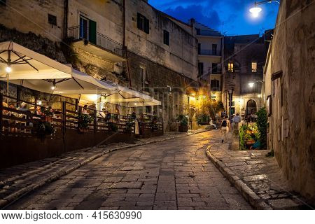 Matera, Italy - September 18, 2019: Evening View Of The City Of Matera, Italy, With The Colorful Lig