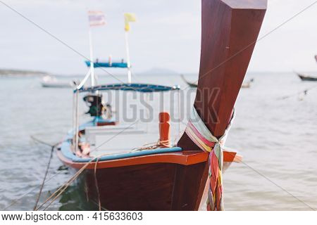 Traditional Thai Wooden Longtail Boat Close Up Photo. Bow Of Long Tail Boat With Beautiful Color. Fi