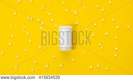 A White Jar With An Empty Label And A Place For The Inscription Lies In The Center Of The Yellow Bac