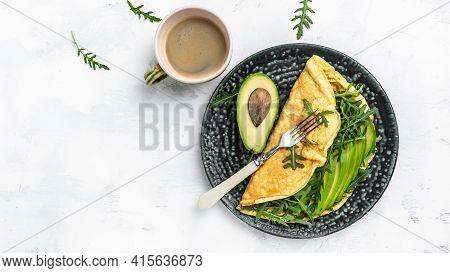 Frittata Italian Omelet With Avocado And Arugula. Delicious Vegan, Vegetarian Breakfast Or Snack On